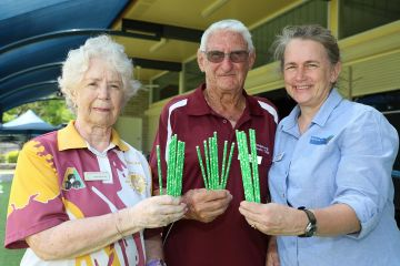 Bundaberg Bowls Club members Marcia Nicol, John Clough and Burnett LMAC chair Sue SargentSue Sargent with the #LessIsMore paper straws.