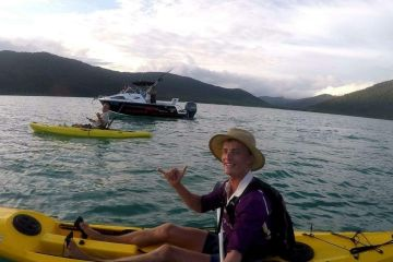 Making a splash for the Reef: Richard Price and Jimmy Barnes paddling through the Whitsundays to fundraise for the Reef